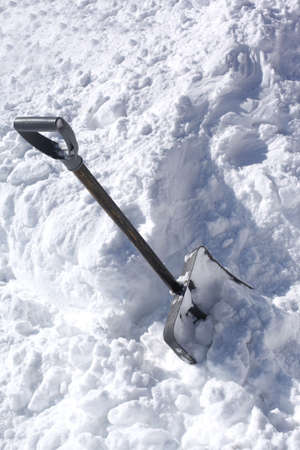 Shoveling snow from driveway: shovel in snow