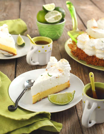 florida citrus: Slice of Key lime pie with fresh limes