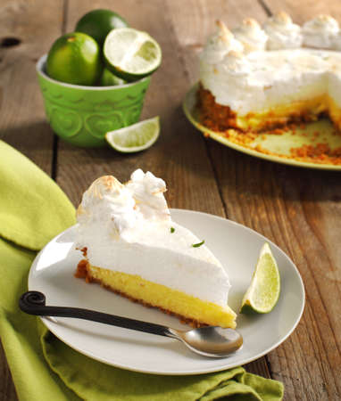 meringue: Slice of Key lime pie with fresh limes