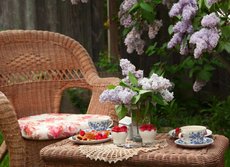 garden furniture: Breakfast at the garden with tea  Selective focus