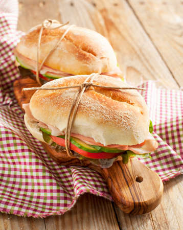 Sandwiches with mortadella and vegetables