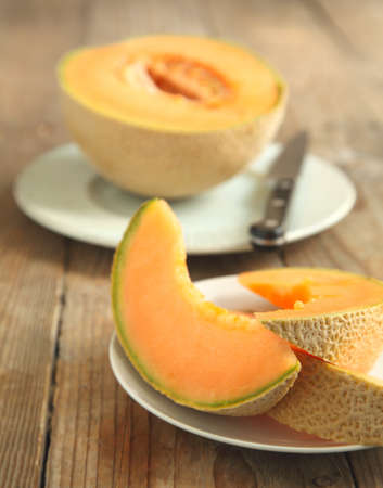 Cantaloupe melon slices photo