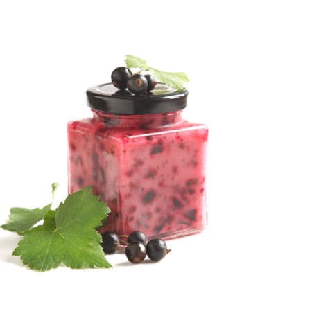 Blackcurrant jam in jar isolated on white background