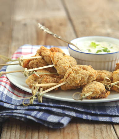 Fried cornmeal-crusted chicken bites with yogurt herb dressing
