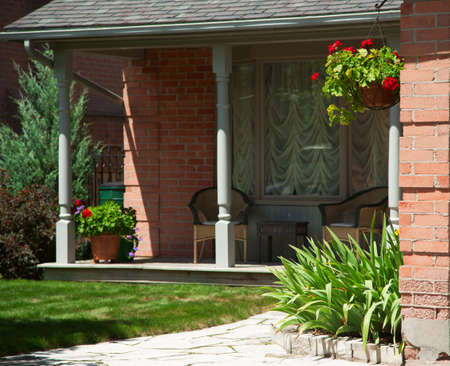 Landscaped front yard of a house with flowers and green lawn photo