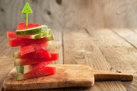 まな板: Slices of watermelon on wooden chopping board 写真素材