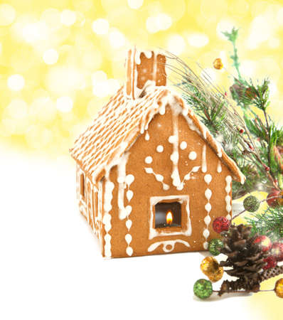 Gingerbread house with Christmas decoration isolated on white background  Selective focus photo
