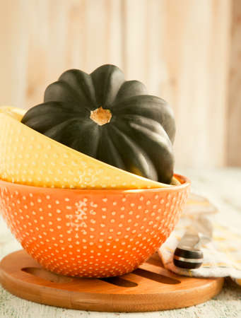 Fresh pumpkin in bowl photo