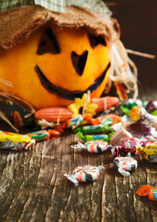 Colorful Halloween candy and Jack-o-lantern photo