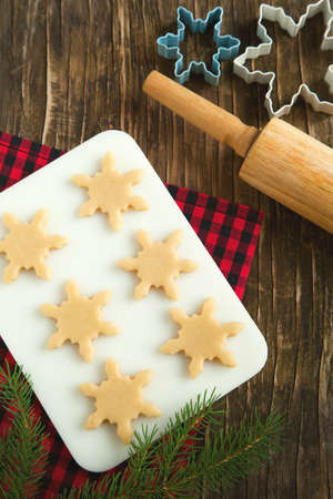 wood cutter: Cutting gingerbread cookies dough homemade for Christmas Stock Photo