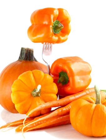 Fresh orange vegetables on a white background  photo