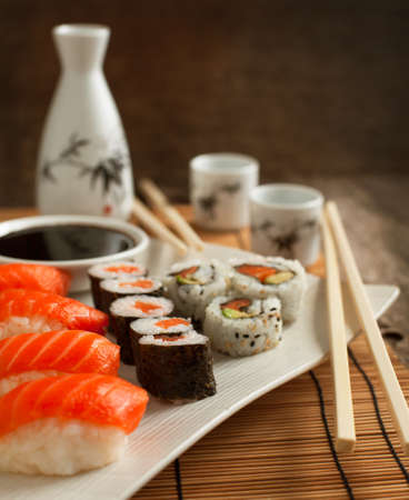 sushi chopsticks: Fresh sushi and rolls on the plate