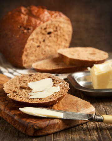 Fresh rye bread and butter photo