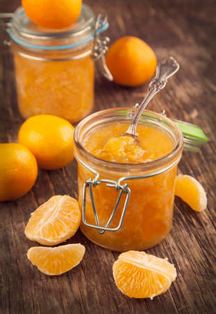 Citrus homemade jam  Selective focus on centre of jar