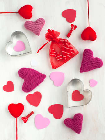 shaped: Valentines Day background with hearts shaped cookies Stock Photo
