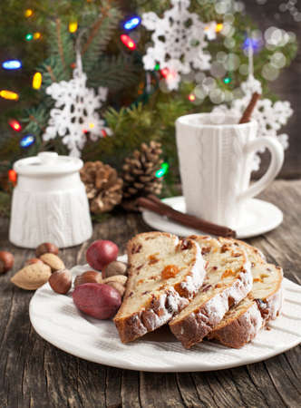 Cup of tea and pieces of Christmas stollen photo