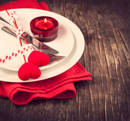 valentine's: Festive table setting for Valentine s Day with fork, knife and hearts Stock Photo