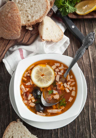 solyanka: Solyanka, Russian soup with meat, sausage, olives and pickles Stock Photo