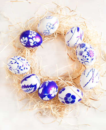 stil: Easter egg wreath on a white wooden background  Selective focus Stock Photo