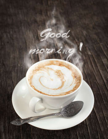 Cup of coffee with words  Good morning  on wooden