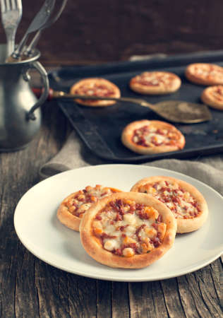 mini pizza: Mini pizza with pepperoni Stock Photo