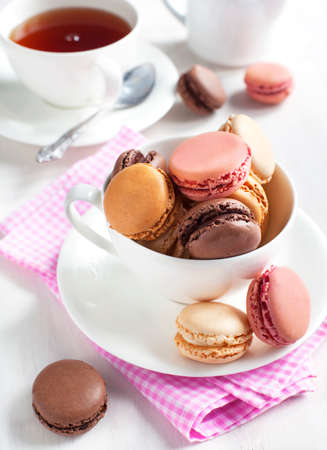 French macaroons   Coffee, chocolate, vanilla and raspberry macarons photo