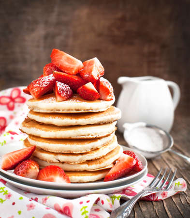 Stack of pancakes with fresh strawberry photo