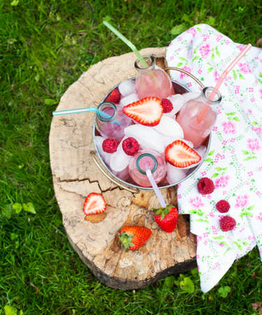 Lemonade with raspberry  Selective focus photo