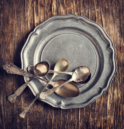 Vintage silverware on rustic metal plate