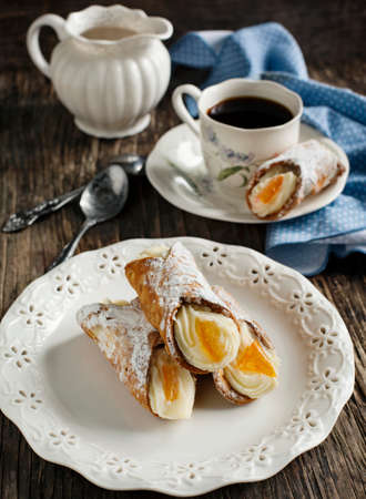 Sicilian cannoli with orange  Typical sicilian pastry photo