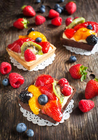 Tartlets with chantilly cream and berries photo