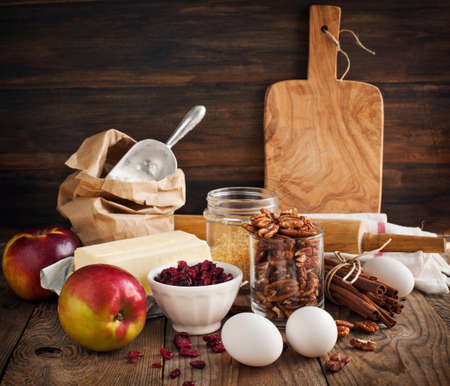 Baking ingredient on wooden background. Fall or winter baking.
