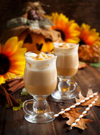 Pumpkin spice latte with whipped cream and caramel photo