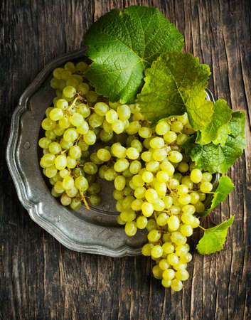Grapes on vintage plate photo