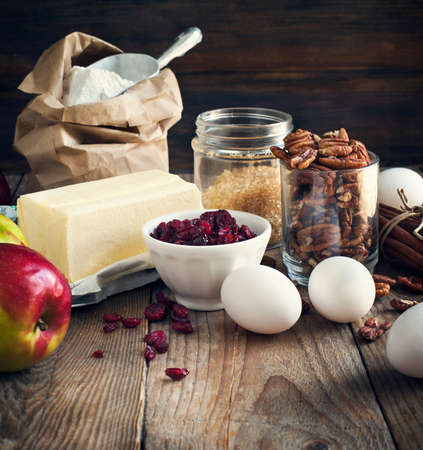 Baking ingredient on wooden background. Fall or winter baking. Toned image photo