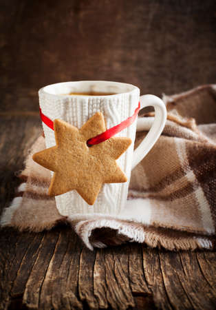 tea and biscuits: Cups of hot tea and gingerbread