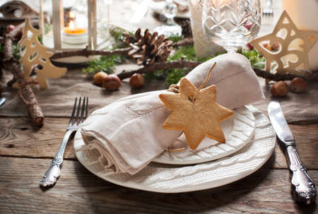 candle light table setting: Christmas table setting. Holiday Decorations. Stock Photo