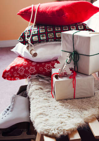 Christmas decoration with pillows and gift boxes photo