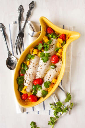 sweet peppers: Baked fish fillet with tomatoes and sweet peppers