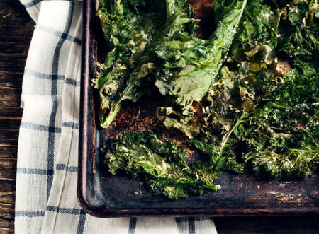 Crispy cheese and chili kale chips on baking tray