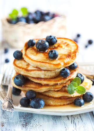 Stack of pancakes with fresh blueberry and honey Stok Fotoğraf