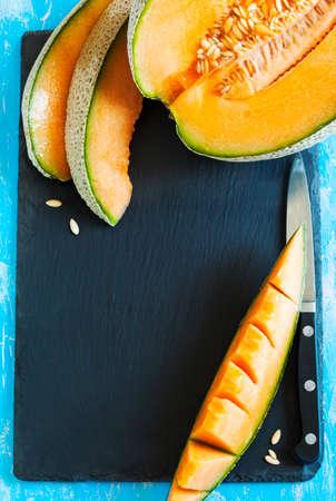 Cantaloupe melon slices. Top view