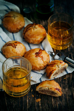 Puff pastry pies with mince meat. Toned image Stock Photo
