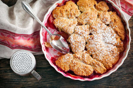 Stewed apple, plum and coconut cobbler.