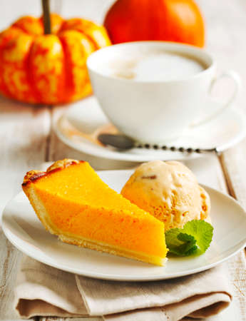 Pumpkin pie served with pumpkin ice cream.