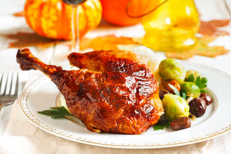 Roasted turkey leg garnished with mash potato, chestnuts and brussels sprouts.