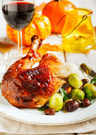 brussels sprouts: Roasted turkey leg garnished with mash potato, chestnuts and brussels sprouts.