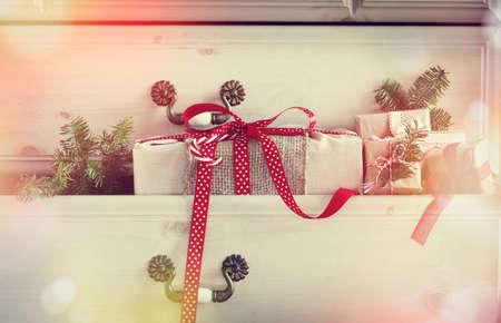 dresser: Christmas gift  in dresser drawer. Toned image