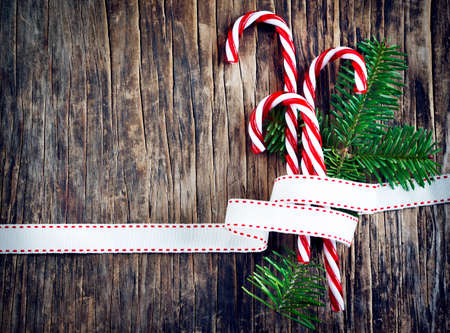 candy border: Candy cane on wooden background
