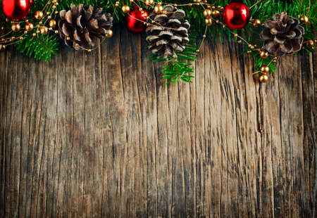 bells: Christmas frame. Christmas fir branches on wooden background with copy space Stock Photo